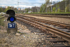 Traffic light in front of the railway turnouts. Detail the traffic light in front of the railway turnouts on tracks Stock Image