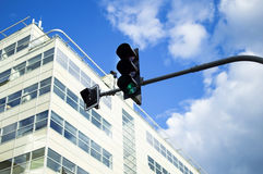 Traffic light green with active against the sky Stock Photography
