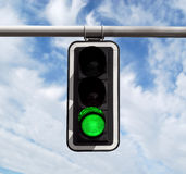 Traffic light - green against sky Royalty Free Stock Photography