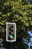 Traffic light with green arrow Stock Images