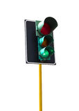 Traffic light isolated on white background is lit green Royalty Free Stock Image