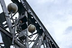 Traffic light and lamps on old bridge, Bratislava Stock Image