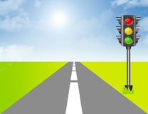 Traffic light with lanscape. Red, yellow, green and black traffic light over landscape Stock Photos