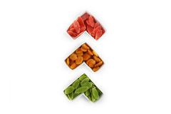 Traffic light made of dried pineapples and apricots. Dried pineapples served in white plates. Green have apple flavor, red are mango flavor - symbols of the royalty free stock image
