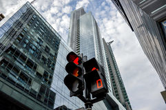 Traffic light in Montreal downtown. Among the skyscrapers.Red light Stock Images