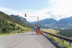 Traffic light on a mountain road Stock Image