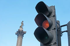 Traffic light and Nelson's Column in background. Traffic light on Trafalgar Square (Nelson's Column  in background Royalty Free Stock Photography
