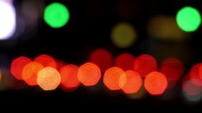 The traffic light in the night out of focus. The action in real time stock footage