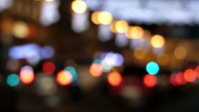 The traffic light in the night out of focus. The action in real time stock video footage