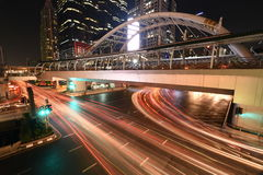 The traffic light  at night on Sathon road,Thailand Stock Image