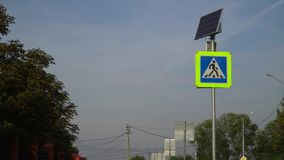 Traffic light with pedestrian crossing sign. The light is powered by solar energy. stock video footage