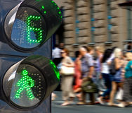 Traffic light on people walking background Royalty Free Stock Photo