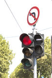 Traffic light and prohibited turn sign Stock Photo
