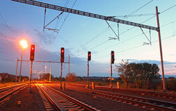 Traffic light in railroad. At dusk Royalty Free Stock Images