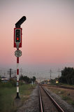 Traffic light on railway. Traffic light shows red signal on railway Royalty Free Stock Photography