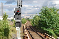 Traffic light and railway track. View of a railway track and a traffic light Royalty Free Stock Photo