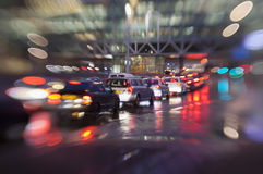 Traffic light in rain city Stock Images