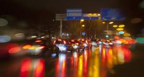 Traffic light in rain city Stock Image