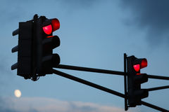 Traffic light. With red light against the evening sky. Shallow depth of field. Selective focus royalty free stock photography