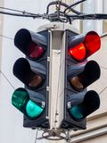 Traffic light with red and green light. A traffic light with red and green light at an intersection stock images