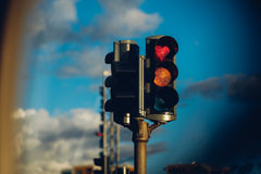 Traffic light with red heart sign. Traffic light with the red signal with the heart sign in the Akureyri, northern Iceland town Royalty Free Stock Photos