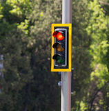 Traffic light on the road in the city.  Royalty Free Stock Photo