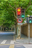 Traffic light set and traffic road sign at intersection Royalty Free Stock Images