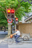 Traffic light set and traffic road sign at intersection Stock Photos