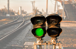 Traffic light shows green signal on railway Royalty Free Stock Images