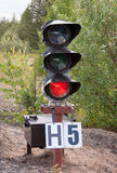 Traffic light shows red signal on railway Royalty Free Stock Photography