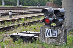 Traffic light shows red signal on railway Stock Photo