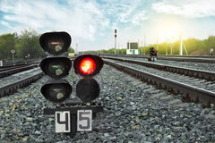 Traffic light shows red signal on railway. Railway station. Travel concept. stock photography