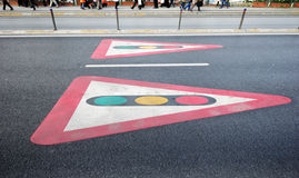 Traffic light signs painted on pavement Stock Photography