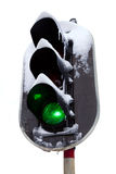 Traffic light in the snow. White background. Stock Photo