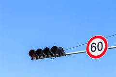 Traffic Light and Speed Limit Sign with Blue Sky. Traffic Light and Speed Restriction Sign with Blue Sky Stock Photography