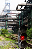 Traffic light is still on in a abandoned steel works Royalty Free Stock Photos