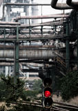 Traffic light is still on at a abandoned steel works Stock Images