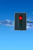 Traffic light. Stop!. Traffic light on a blue sky, red signal is on. Object is isolated and clipping path included Royalty Free Stock Photos