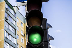 Traffic Light on the street. The green traffic signal against the background of the house Royalty Free Stock Images