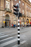 Traffic light on striped post in old central part of Amsterdam Royalty Free Stock Photos