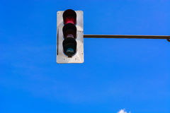 Traffic light and a surveillance camera. A traffic light and a surveillance camera on a pole mounted on the street Stock Photography
