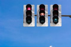 Traffic light and a surveillance camera. A traffic light and a surveillance camera on a pole mounted on the street Royalty Free Stock Photo