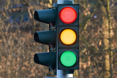 Traffic light. At a traffic light the three colors light up red, yellow and green at the same time royalty free stock photos
