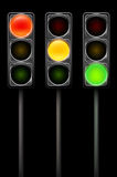 Traffic light in three positions on black background Stock Photos