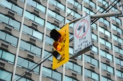 Traffic light in Toronto downtown, Canada. No turn sign royalty free stock photos