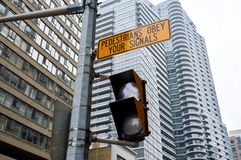 Traffic light in Toronto downtown. Toronto, Canada - November 16, 2016: Traffic light in Toronto downtown, Canada. Pedestrians obey your signals stock image