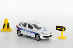 Traffic light and toy police car Stock Photos