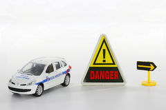 Traffic light and toy police car Royalty Free Stock Image