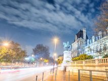 Traffic light trails on city streets at night, Paris.  Royalty Free Stock Photos