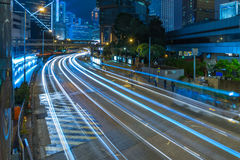 Traffic light trails in downtown of Hong Kong Royalty Free Stock Photo